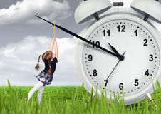 Little child pulling hand clock, time stop concept Stock Photography