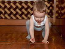 Little child put parquet. A two-year-old child in the job Stock Image