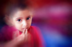 little child putting finger on mouth with small hairs Stock Photography