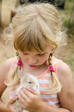 Little child with rabbit Stock Photography