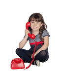 Little child with a red phone Stock Photography
