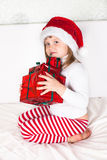 Little child in red santa hat on white background. portrait Stock Photo