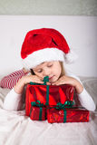 Little child in red santa hat on white background. portrait Royalty Free Stock Photography