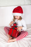 Little child in red santa hat on white background. portrait Royalty Free Stock Photos