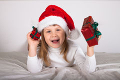 Little child in red santa hat on white background. portrait Stock Image