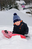 Little child with red sledge Royalty Free Stock Photo