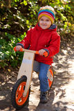 Little child riding bicycle Stock Images
