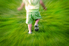Little Child Running in Grass Having Fun Royalty Free Stock Image