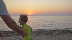 Little child running into parents hugs stock video