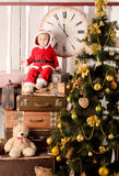 Little child in santa costume at christmas tree Royalty Free Stock Images