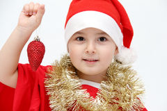 Little child with santa hat Stock Images