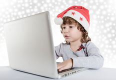 Little child with Santa hat Royalty Free Stock Images