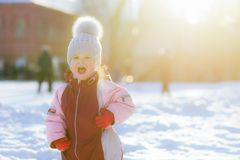 little child screams outdoors in winter against sunset background royalty free stock photo