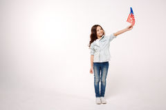 Little child showing American symbolic in the studio Royalty Free Stock Photo