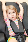 Little child sits in a car seat Royalty Free Stock Photo