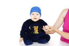 Little child sitting in a blue cap Stock Images