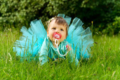 Little child is sitting in the grass on nature Royalty Free Stock Images