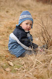 Child sitting on the ground Stock Photo