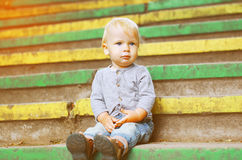 Little child sitting outdoors summer Stock Images