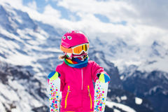 Little child skiing in the mountains Royalty Free Stock Image