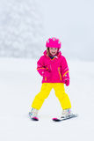 Little child skiing in the mountains in winter Royalty Free Stock Photo