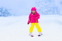 Little child skiing in the mountains in winter Stock Images
