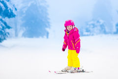 Little child skiing in the mountains in winter Stock Photography