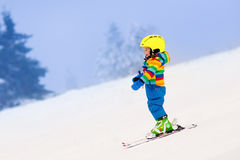 Little child skiing in the mountains in winter Royalty Free Stock Photography