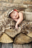 Little child sleepieng on the piece of wood Stock Image