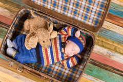 Little child sleeping in suitcase. Royalty Free Stock Images