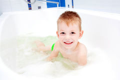 Little child smiling in bath. Happy childhood Royalty Free Stock Images