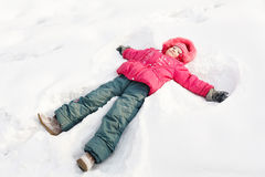 Little child in a snow Stock Images