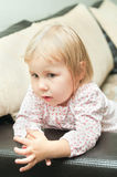 Little child on sofa Stock Photos