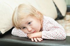 Little child on sofa Stock Image
