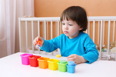 Little child sorts details by color Stock Photography
