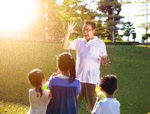 Little child spray water to father together by water guns stock photography