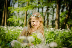 Little child in springtime in forest Royalty Free Stock Photo