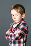 Little child standing from profile expressing his disappointment or shame Stock Photos