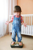 Little child standing on a scale Stock Photography