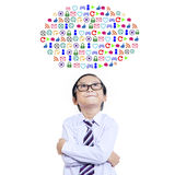Little child standing under web icons Royalty Free Stock Photo