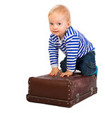 Little child  with a suitcase  isolated. The beautiful little child  with a suitcase  isolated on a white background Royalty Free Stock Photography