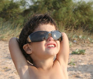 Little child in sunglasses Stock Images