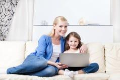 Little child surfs on the internet Stock Images