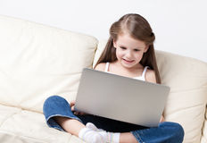 Little child surfs on the internet Royalty Free Stock Photography
