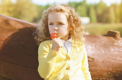 Little child with sweets having fun Stock Image