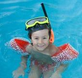 Little child swimming stock photos