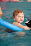 Little child in swimming pool. The little child in swimming pool royalty free stock photos
