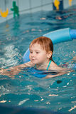 Little child in swimming pool. The little child in swimming pool stock photos