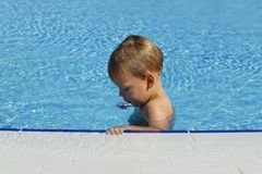Little child in the swimming pool. Cute toddler in the pool.  stock image