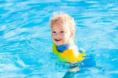 Little child in swimming pool Stock Photography